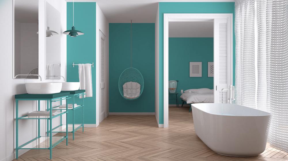 aseo con sanitarios en blanco y pared en azul turquesa