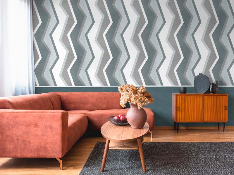 salon son sofa y papel pintado con forma geometrica