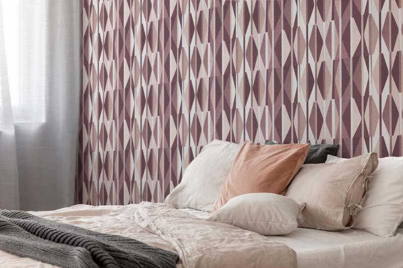 cama conn papel pintado geometrico
